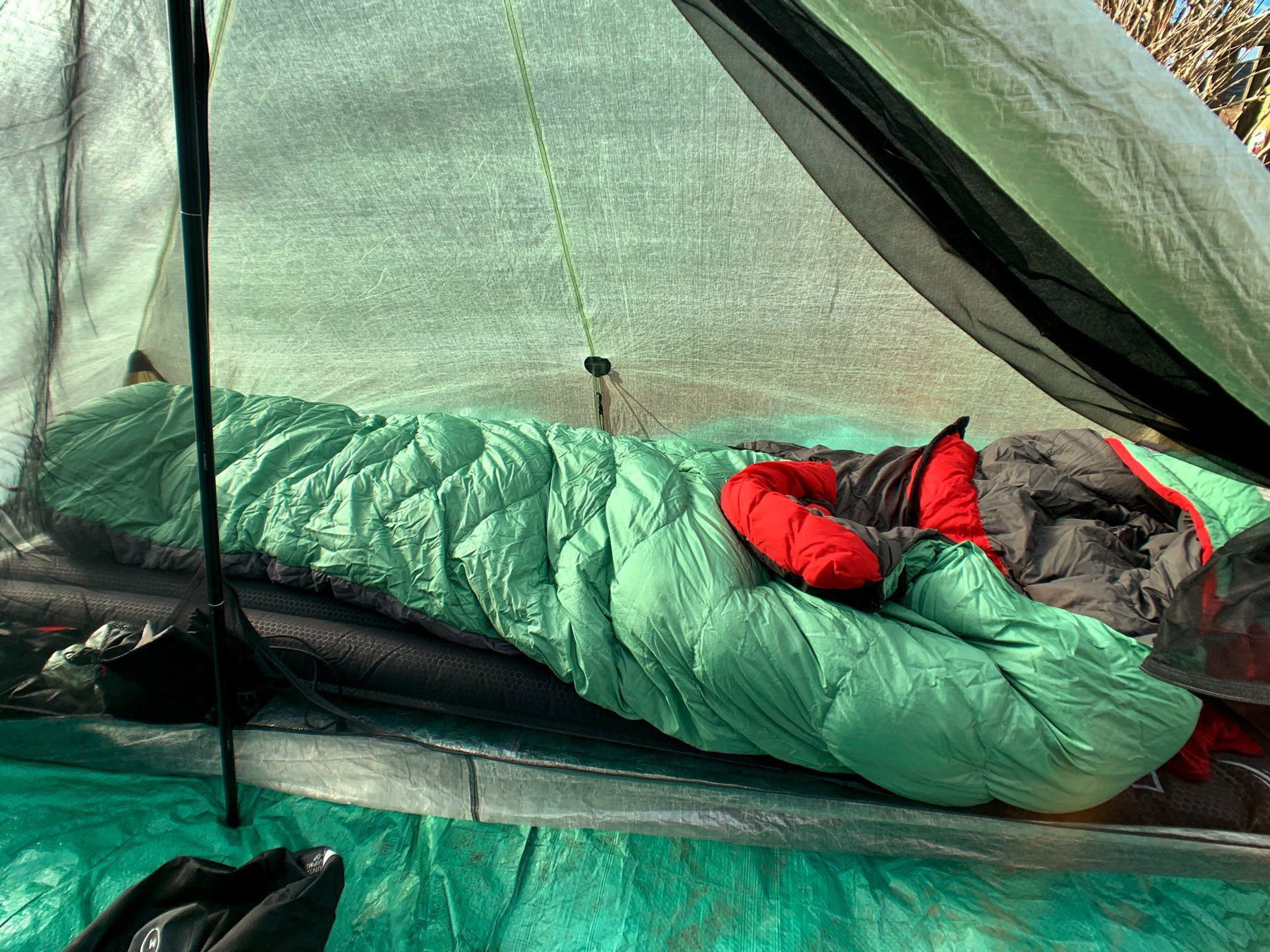 the inside of a tent with a winter sleeping bag unfurled