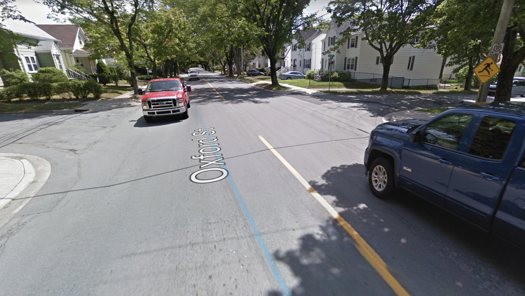 Google Streetview of Berlin & Oxford showing two giant pickup trucks driving down Oxford Street.