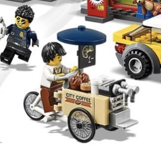 A Lego cargo bike in a city scene
